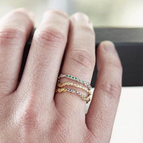 Anais Rheiner stacking white gold ring and emeralds